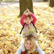 Young mother and her little daughter on the nature — Stock Photo #14249577