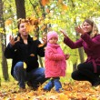 Stock Photo: Young family in nature