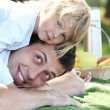 Young father with his daughter on picnic — Stock Photo