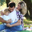 Young family with a daughter at a picnic — Stock Photo #18005851
