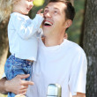 father play with his daughter on picnic — Stock Photo