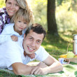 Young family with a daughter at a picnic — Stock Photo