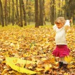 Beautiful little girl in the autumn forest with umbrella — Stock Photo #18006047