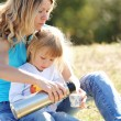 Mother with her daughter at a picnic — Stock Photo