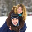 Young couple in winter park — Stock Photo