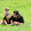 Couple in love with little daughter outdoors — Stock Photo