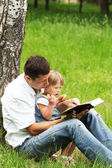 Beautiful little girl with her father on nature — Stock Photo