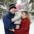 Young family with child in the park in winter — Stock Photo