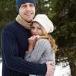 A young couple in love in the park in winter — Stockfoto