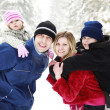 Young family with children in the park in winter — Stock Photo