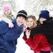 Stock Photo: Young family with children in the park in winter