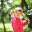 Little girl with bubble — Stock Photo #19053421