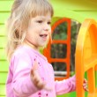 Little girl with children's playhouse — Stock Photo #19053611