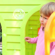 Little girl with children's playhouse — Stock Photo #19053619
