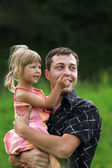 Little girl play with dad in nature — Stock Photo