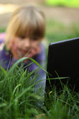 Little girl with a laptop, — Stock Photo