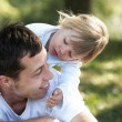 Beautiful little girl with dad playing  — Stock Photo