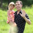 Stock Photo: Little girl play with dad in nature