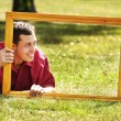 Man in the picture frames — Stock Photo #20133237