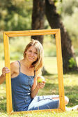 Young woman in a frame — Stock Photo