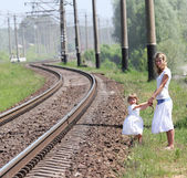 Railroad and a mother with her daughter — Stock Photo