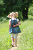 Beautiful little girl on nature, — Stock Photo