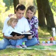 Family read Bible in nature — Stock Photo #22218265