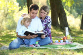 Family read the Bible in nature — Stock Photo