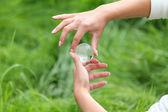 Glass globe in hand — Stock Photo