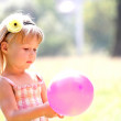 Beautiful little girl in nature with balloons — Stock Photo