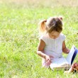 Stock Photo: Beautiful little girl in nature with book