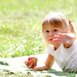 Stock Photo: Beautiful little girl outdoors with apple