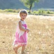 Stock Photo: Beautiful little girl on nature