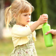 Little girl with soap bubbles — Stock Photo