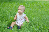Beautiful little girl on the grass — Stock Photo