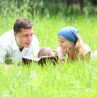 Young family reading the Bible — Stock Photo #24736121