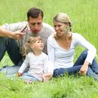 Young family on the nature - Stock Photo