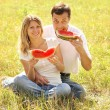 couple in nature eat watermelon — Stock Photo