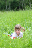 Beautiful little girl on the nature — Stock Photo