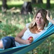 Young woman in a hammock - Stock Photo