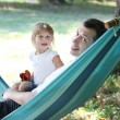 Father with his small daughter in a hammock - Стоковая фотография