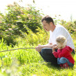 Dad and little daughter near a lake — Stock Photo #25287903