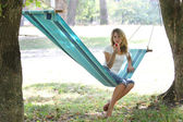 Young woman in a hammock — Stock Photo
