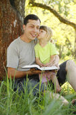 Father with his little daughter reads the Bible — Foto Stock