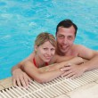 Loving couple in the water pool — Stock Photo