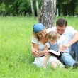 Young family reading the Bible — 图库照片