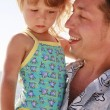 Dad and little daughter on the beach — Stock Photo