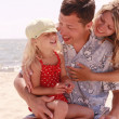 Young family on the beach — Stock Photo