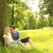 Pregnant couple in love outdoors — Stock Photo