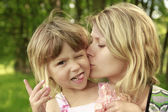 Mama and her little daughter playing — Stock Photo